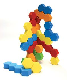 Hexactly - magnetic wooden blocks in the shape of... you guessed it: hexagons, allow kids to create amazing sculptures.