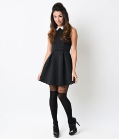 Party like it's 1965! This marvelous mod look boasts an A-line flare shape in all black, topped off with a cheeky white...Price - $52.00-2rvy3VGd