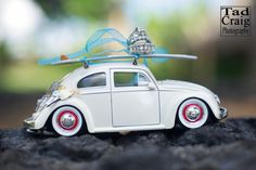 VW bug holding a surfboard and wedding rings for a destination wedding on Maui, Hawaii.  Photo by www.TadCraigPhotography.com
