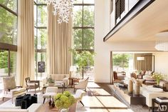 A floral light sculpture by U-Ram Choe glimmers in the living room of Jennifer and Billy Frist's modern Tennessee home