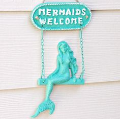 Everyone is welcome, including mermaids. Iron mermaid welcome sign, cast iron, painted.