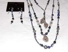 """Indus Iolite - This is a lovely 22 three-strand Iolite Gemstone necklace. Iolite is known as a """"water sapphire"""" or the"""" Viking stone."""" The Vikings used Iolite as a lens to see during ocean voyages; thus, it was the world's first polarizing filter. Truth, simplicity, imagery, and peace are associated with Iolite. It is one of the best stones to use in healing and spiritual activities. These lovely blue Iolite Beads, Freshwater Pearls, and Seed Beads blend well with the clear Swarovski…"""