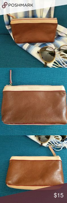 Dooney & Bourke Cosmetic Case Saddle Leather with natural leather trim.  Excellent condition.  One very small spot on back trim of bag (see last pic) Dooney & Bourke Bags