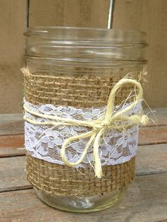 mason jars with twine, burlap and lace. I love this idea for table decor. rustic, chic. Very appropriate : )
