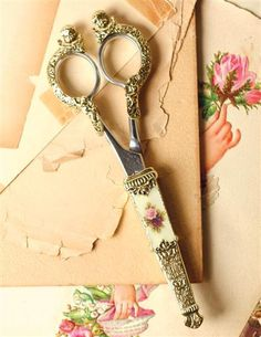 Dressmaker quality scissors are cast from an ornamental  mold with cherubs atop.