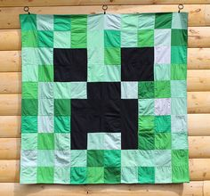 I might know a kiddo or two who would love this... Minecraft Creeper Quilt