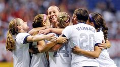 The U.S. women celebrated early, and often, in their 4-0 victory over Australia on Oct. 20, 2013, in the Alamodome in San Antonio. (Darren Abate/AP)