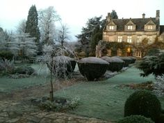 Barnsley House, glowing in mid winter morning sun, the Cotswolds