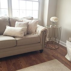 Cozy living room. Warm beige and whites. Paint color: Calico Cream sherwin Williams. Milari sofa in cream. Easy colors to update looks great in any home. My favorite place to sit!! End table: homegoods for under $50!!