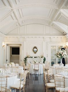 classic and elegant wedding reception decor | gold chiavari dining chairs and white table linens with neutral flowers | Classic Washington D.C. Ballroom Wedding