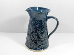 Slate blue pottery pitcher vase with a carved vine and leaf design by TamarackStoneware