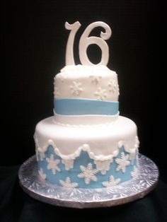 Sweet 16 cake for winter wonderland theme. Snowflakes and snow caps in blue. www.joscakesandcatering.com