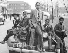 Negro Boys on Easter Morning. Southside Chicago, Illinois the Library of Congress' digital photograph collection . Five young boys sitting on a vintage Pontiac in Chicago. Original black and white photo colorized added beautiful detail to an iconic photo. South Side Chicago, Black Boys, Black Men, Black White, Harlem Renaissance, Idda Van Munster, Classy People, We Are The World, Louis Armstrong