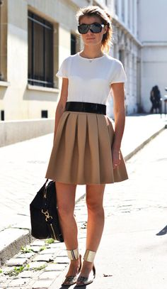 outfit: white tee, beige pleated miniskirt, black belt, black sunglasses, black handbag, sandals