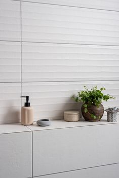 The Fusuma range features wall tiles with distinctive textured plaster appearances that emulate contemporary style. Available in two neutral shades; White & Ivory and a gorgeous décor option (pictured), our Fusuma tiles offer a modern twist on plaster and fabric effects.   With a tactile texture and sleek finish, these tiles won't look out of place in an modern bathroom.