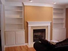 Fireplace and built in shelves in living room