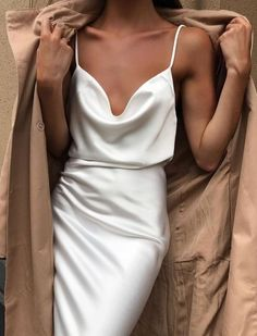 A timeless slip dress is the wardrobe staple that brings a touch of luxury to even your most understated outfit and the perfect piece to upgrade your working from home wardrobe. 70s Fashion, Korean Fashion, Fashion Dresses, Womens Fashion, Fashion Belts, Spring Fashion, Winter Fashion, Fashion Tips, Fashion Trends