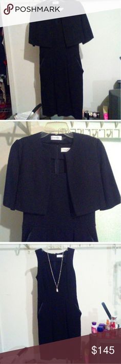 """? Calvin Klein Black Dress ? Shell: 72% Rayon, 24% Nylon, 4% Spandex 2 pc Set - bought as a set. Beautiful black dress by Calvin Klein. Fun Fact - Michelle Obama wore this exact dress while First Lady.  This dress is stretchy. Worn 1x.   Cropped Mini Jacket Measurements  Bust: 17""""-18""""  -  Length: 14"""" Dress Measurements: Bust: 17"""" Length: 38"""" Zipper in back of dress. The side pockets were what really made me want it.  This was purchased online at CalvinKlein.Com   Size 4 - fits Medium. Calvin…"""