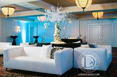 We love this furniture set up by Luma Designs with blue lighting and elegant decor! Click the image to learn more. Photo credit: Luma Designs webpage