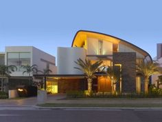 Greg Shand Architects have designed a waterfront house in Sentosa Cove, Singapore named Nautical Lines.