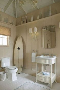 Coastal cottage bathroom complete with surfboard