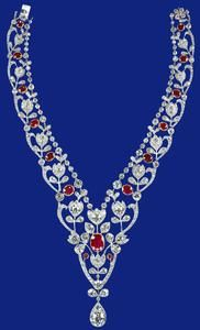 Ruby & diamond necklace, c 1907, The necklace was ordered by The Hon Mrs Ronald Greville from Boucheron in Paris on 24 October 1907. It was among the splendid jewels bequeathed by Mrs Greville to Queen Elizabeth in 1942 and was given to Princess Elizabeth as a wedding present in 1947. The necklace was subsequently shortened by the removal of two of the smallest flower clusters. The Royal Collection.