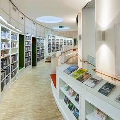 Library Design | Clapham Library by Studio Egret West | Like everything about this realy...curves, light, display, function, intergration....perfect...