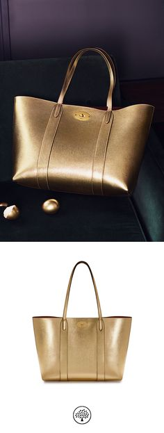 Shop the Bayswater Tote in Gold Metallic Printed Goat Leather at Mulberry.com. The perfect everyday bag, the Bayswater Tote is eternally practical; spacious enough to fit essentials from an iPad to a pair of shoes. This classic style closes with the iconic postman's lock, and features a luxurious suede lining. Use the internal, removable pocket to store your most valued essentials.