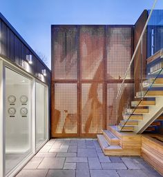 Mount Pleasant House by Roundabout Studio,Toronto, Canada - perforated, back-lit corten steel panels in the courtyard