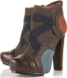 6. Android Panel Ankle Boots    Price: $160.00 at us.topshop.com  Another pair of super-chic color block boots that are going to rock your world and everyone in it! Aren't …