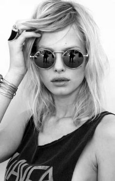 dark glasses / blonde hair / sleeveless / black and white fashion
