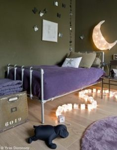 <3 paper moon wall light : looks like paper or muslin + a moon-shaped wire frame + string of lights