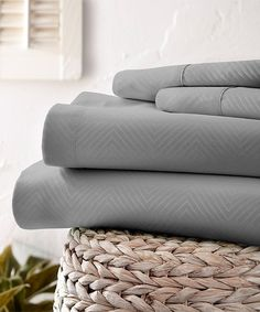 Snuggle into bed with this ultra-soft microfiber sheet set that boasts a rich, neutral tone to blend with existing bedding and is oversize for roominess and comfort.Includes flat sheet, fitted sheet and two pillowcases (twin sizes include one pillowcase)Fits mattresses up to 16'' deep100% microfiber polyester90 GSMMachine wash; tumble dryImported