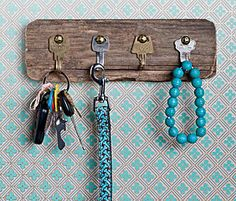 Turn your old mystery keys into a holder simply. Transform some castoffs, like a piece of an old wooden fence and keys, to hold and organize your current stash: dog leashes, necklaces, current key rings, headsets, bracelets, and more.
