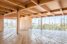 Glass facade reveals timber structure of Portland office building