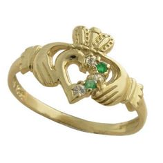 A uniquely handcrafted gold part set heart Claddagh ring, delicately set with two glistening diamonds and two precious emeralds. Claddagh Symbol, Claddagh Rings, Celtic Wedding Rings, Celtic Rings, Irish Wedding Traditions, Celtic Spiral, Irish Rings, Celtic Designs, Unique Rings