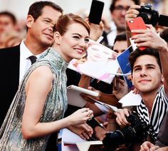 Emma Stone signs autographs as she arrives for the opening ceremony and screening of 'La La Land' at the 73rd annual Venice International Film Festival, in Venice, Italy, 31 August 2016.