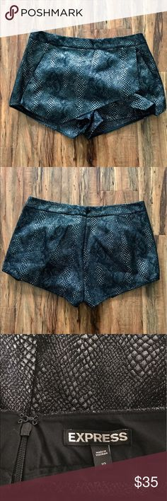 Express black and silver metallic shorts Black shorts with silver metallic stitching. Shorts in the back and a panel on the front to look like a skirt. Size 10. Express Shorts