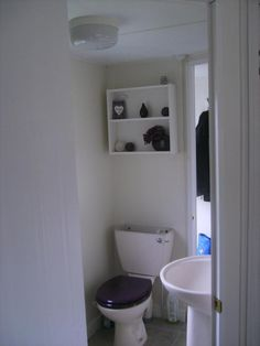 Bathroom after - painted walls, new flooring and accessories
