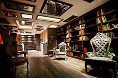 minus the furniture and the mirrors on the ceiling, this would be perfect as a  home library in a large house.