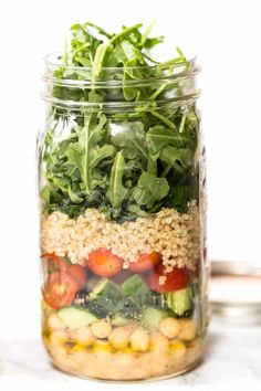 Chickpea & Quinoa MASON JAR SALADS -- perfect for a healthy office lunch! Add everything into your jar, dump into a bowl and enjoy!