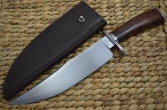 Direct from Mike Ruth J. is this high quality forged Bowie knife. Mike forged the blade from 1084 steel, used stabilized Desert Ironwood for the handle, and 416 stainless for the fittings. Mike is known for his outstanding Bowies and Hunters. Hobbies For Men, Handmade Knives, Knives And Swords, Axe, Metal Working, Deserts, Bowie Knives, Knifes, Leather