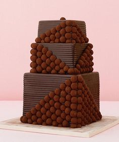 forget the dessert bar! add the chocolates right to the cake! just make sure there is the same number of truffles as guests! Types Of Wedding Cakes, Pretty Wedding Cakes, Amazing Wedding Cakes, Unique Wedding Cakes, Wedding Desserts, Pretty Cakes, Beautiful Cakes, Amazing Cakes, Haute Chocolate