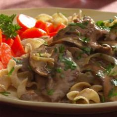 Our version of beef Stroganoff tops seared flank steak with a rich-tasting sauce made with a touch of cognac, reduced-fat sour cream and plenty of portobello mushrooms.