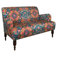 Brimming with wayfaring appeal, this pine wood-framed settee showcases medallion-print upholstery for bold style. Handmade in the USA.