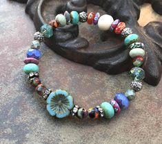 Czech Flower designed around Beautiful Glass Beads, Czech Glass and Agate with vintage rhinestone spacers and Ba;i silver. Great addition to your Fall Jewelry. light weight and Elegant. They are BEAUTIFUL!! Just love!!! Bracelets can be designed in the size you need. Just convo:) this