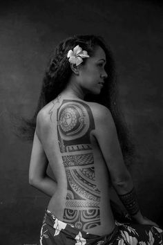 Woman with polynesian halfback tattoo.