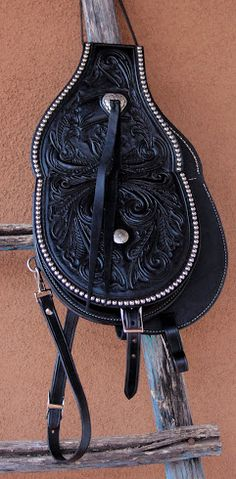 HAND-TOOLED LEATHER SADDLE SHOULDER BAG