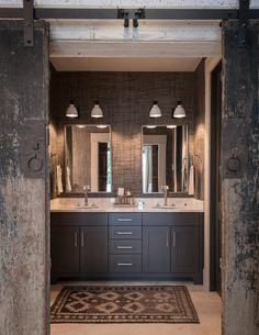 Masculine bathroom with reclaimed barn doors, grey natural fiber wallpaper and charcoal grey vanity. Architecture: Locati Architects. Interior Design by Cashmere Interior. Photography by Audrey Hall.