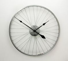 This Tread & Pedals Large Wall Clock is handcrafted from a recycled road bicycle wheel and set of cogs. The high quality clock mechanism is hidden